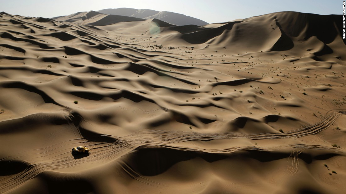 The car of Wein Han and Jean-Pierre Garcin travels through the Gobi Desert of Inner Mongolia as they race in the Silk Way Rally on Friday, July 22. The event started in Moscow and ended in Beijing.