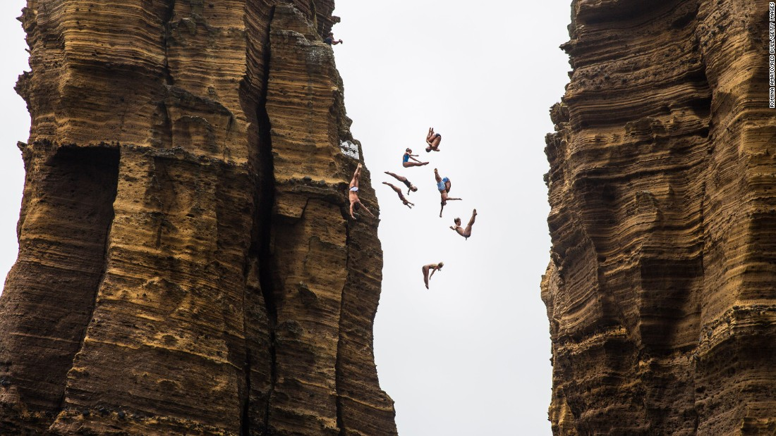 Divers jump off a 72-foot monolith in Portugal's Azores region before a Cliff Diving World Series event on Thursday, July 7.