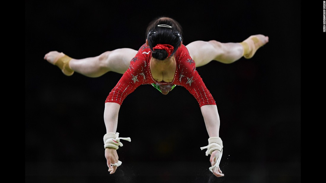 Chinese gymnast Tan Jiaxin competes on the uneven bars during the Olympics on Sunday, August 7.