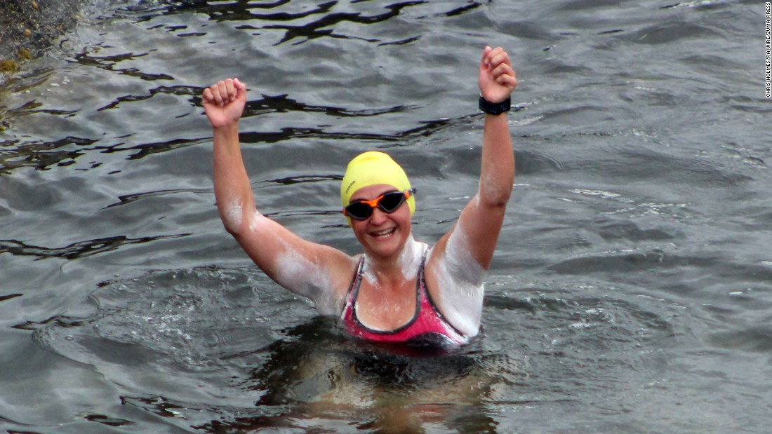 "Heather Clatworthy celebrates Wednesday, July 27, after she became the first swimmer in nearly 90 years to cross a 13-mile stretch of sea off Ireland's north coast. <a href=""https://www.swimmingworldmagazine.com/news/heather-clatworthy-becomes-first-to-swim-moville-to-portstewart-since-1929/"" target=""_blank"">She swam from Moville to Portstewart</a> in four hours and 15 minutes."