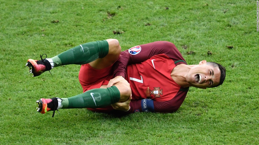 "Cristiano Ronaldo reacts after a tackle by Dimitri Payet during <a href=""http://www.cnn.com/2016/07/10/football/france-portugal-euro-2016-final/index.html"" target=""_blank"">the Euro 2016 final</a> between Portugal and France on Sunday, July 10. Portugal won despite Ronaldo being forced to leave the game with a knee injury."