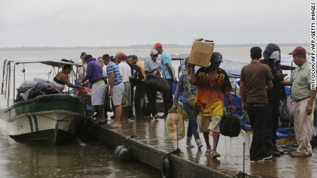"Local residents embark on boats to leave before Hurricane Otto arrives in Bluefields, Nicaragua on November 23, 2016.  A Caribbean storm verging on a hurricane spun towards the coasts of Costa Rica and Nicaragua on Wednesday, prompting evacuations and red alerts ahead of ""life-threatening"" flash flooding. / AFP / INTI OCON        (Photo credit should read INTI OCON/AFP/Getty Images)"