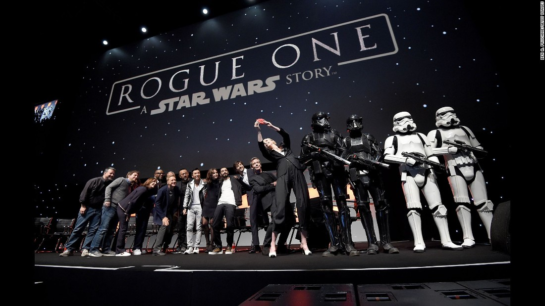 "The cast of the upcoming movie ""Rogue One"" poses for an on-stage selfie during a ""Star Wars"" celebration in London on Friday, July 15."