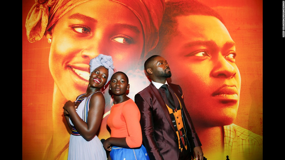 "From left, actors Lupita Nyong'o, Madina Nalwanga and David Oyelowo re-enact their ""Queen of Katwe"" poster during the movie's premiere in Los Angeles on Tuesday, September 20."