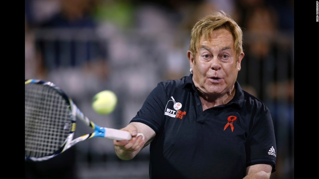 Singer Elton John hits a ball during a World Team Tennis exhibition to benefit the Elton John AIDS Foundation on Monday, October 10.