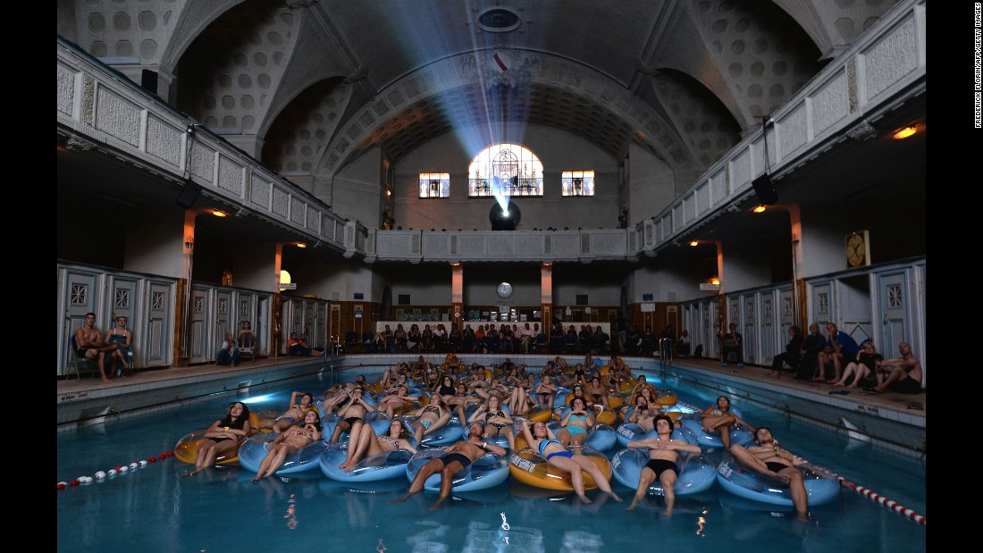 "People watch the 1975 classic ""Jaws"" from a swimming pool in Strasbourg, France, on Sunday, September 18."