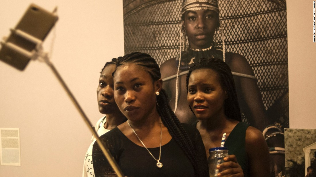 Smartphone sales now account for 23% of the mobile phone market. These sales are set to increase as infrastructure is modernized and network coverage improves. <br /><br />Pictured: Visitors take selfies during the opening of the Lagos Photo festival in Lagos on October 22, 2016.