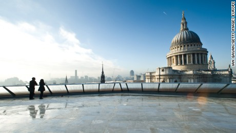 LONDON, ENGLAND - NOVEMBER 16:  A couple admire the view of St Pauls Cathedral from the rooftop terrace of the One New Change building on November 16, 2010 in London, England.  (Photo by Ian Gavan/Getty Images for One New Change)