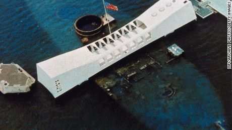 circa 1962:  An aerial view of the USS Arizona National Memorial, which spans the sunken hull of the battleship in Pearl Harbor, Oahu, Hawaii, and commemorates the site where the Japanese attacked on December 8, 1941 bringing America into World War II, and as a memorial to all the military personnel killed that day. (Photo by MPI/Getty Images)