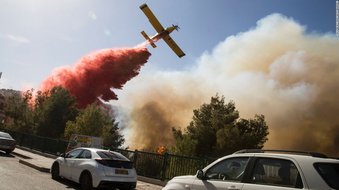 "A firefighter plane drops retardant on a wildfire in Haifa, Israel, on Thursday, November 24. Israel is <a href=""http://www.cnn.com/2016/11/24/world/israel-wildfires-netanyahu-putin/"" target=""_blank"">battling its most serious wildfires</a> since 2010."