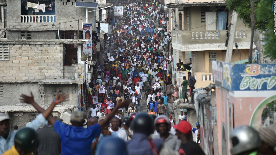 Supporters of Haitian presidential candidate Maryse Narcisse march in Port-au-Prince on Tuesday, November 22, two days after the election. At press time, votes were still being tabulated.