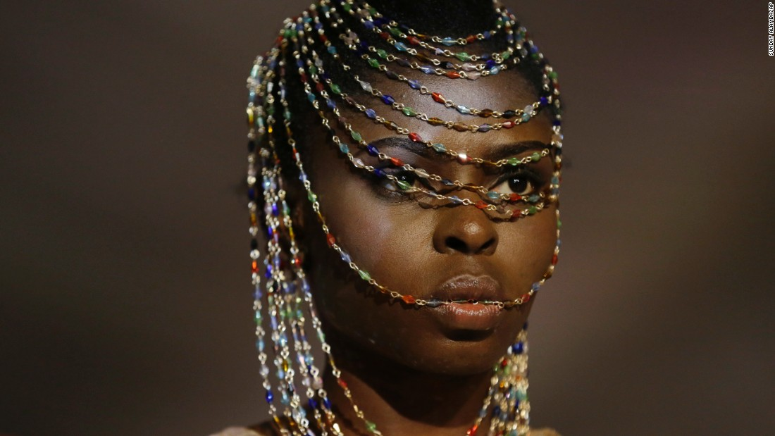A model wears a creation by Maxine Laces Coll during a fashion show in Lagos, Nigeria, on Friday, November 18.
