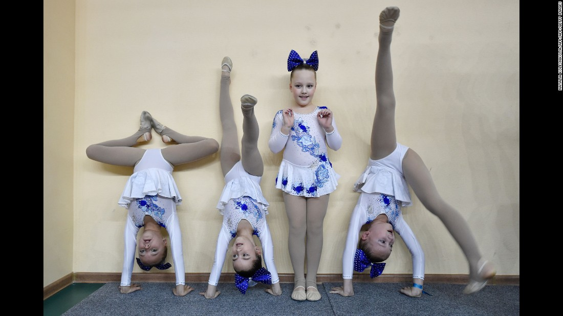Young cheerleaders warm up at the Russian Cheerleading Championship in Moscow on Sunday, November 20.