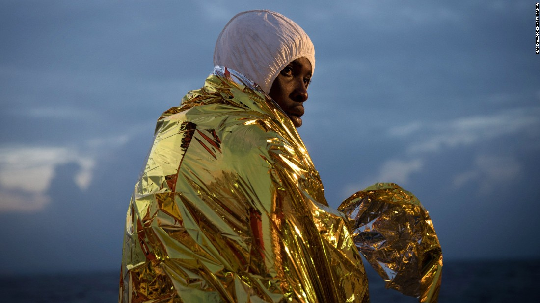 "A migrant from West Africa wears a survival blanket aboard a search-and-rescue vessel in Pozzallo, Italy, on Wednesday, November 23. <a href=""http://www.cnn.com/2015/09/03/world/gallery/europes-refugee-crisis/index.html"" target=""_blank"">Europe's migration crisis in 25 photos</a>"