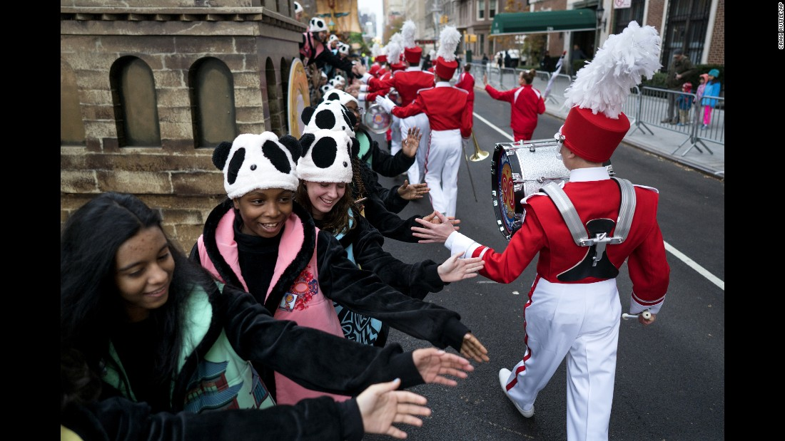 Band members give high-fives during the parade.