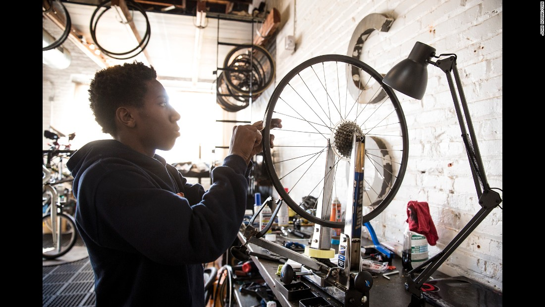 Richmond Cycling Corps' member Devonte, 17, picks out a bicycle and fits it with new tires at the Richmond Bicycle Studio.