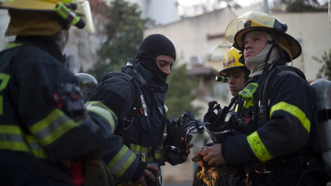 Israeli firefighters work in Haifa on November 25.