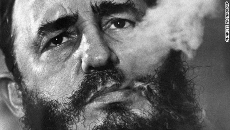 FILE - In this March 1985 file photo, Cuban Prime Minister Fidel Castro exhales cigar smoke during an interview at his presidential palace in Havana, Cuba. Castro, a Havana attorney who fought for the poor, overthrew dictator Fulgencio Batista's government on Jan. 1, 1959. As Castro turns 90 on Aug. 13, 2016, it's an uncertain time, with no settled consensus around his legacy. The government and its backers laud Castro's nationalism and his construction of a social safety net that provided free housing, education and health care to every Cuban. Less is said about decades of economic stewardship that, along with a U.S. trade embargo, has left Cuba's infrastructure and its economy cash-strapped and still dependent on billions in aid from abroad. (AP Photo/ Charles Tasnadi, File)