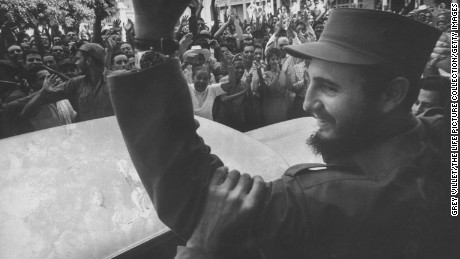 Crowds cheer Castro on his victorious march to Havana after ousting dictator Fulgencio Batista.