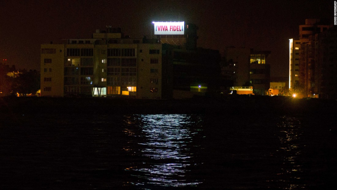 "A sign that reads, ""Long live Fidel,"" stands on a government building in Havana early November 26."
