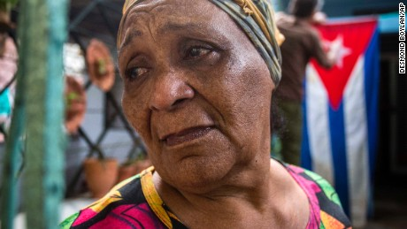 Rafaela Vargas mourns the death of former President Fidel Castro at the entrance of her home in the Vedado neighborhood in Havana, Cuba, Saturday, November 26. Castro, who led a rebel army to improbable victory in Cuba, embraced Soviet-style communism and defied the power of U.S. presidents during his half century rule, died at age 90.