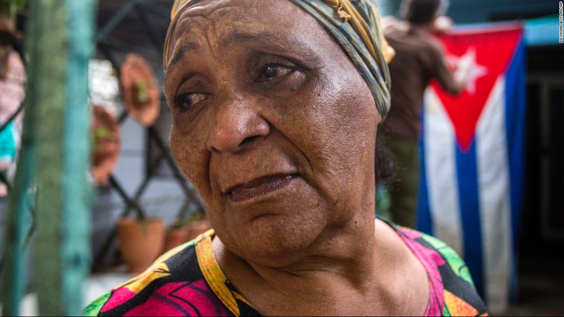 Rafaela Vargas mourns the death of former President Fidel Castro at the entrance of her home in the Vedado neighborhood in Havana, Cuba, on Saturday, November 26.