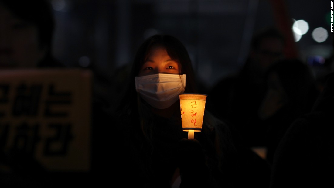 "The country's stagnating economy and the Sewol ferry sinking, which killed more than 300, have also contributed to growing dissatisfaction. (Read the full story <a href=""http://edition.cnn.com/2016/11/26/asia/south-korea-mass-protests/index.html"" target=""_blank"">here</a>)"
