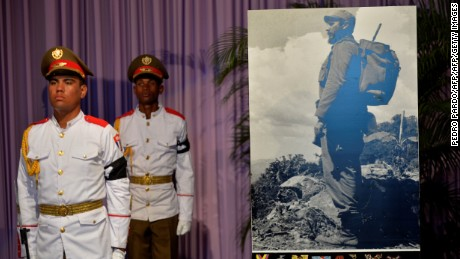 Cuban soldiers stand guard while people pay their last respects to Cuban revolutionary icon Fidel Castro kicking off a series of memorials in Havana, on November 28, 2016.  A titan of the 20th century who beat the odds to endure into the 21st, Castro died late Friday after surviving 11 US administrations and hundreds of assassination attempts. No cause of death was given. Castro's ashes will go on a four-day island-wide procession starting Wednesday before being buried in the southeastern city of Santiago de Cuba on December 4. / AFP / PEDRO PARDO        (Photo credit should read PEDRO PARDO/AFP/Getty Images)