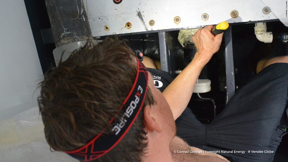 Colman, born in New Zealand and with an interest in sailing since his childhood, works on the hydraulic system for canting his yacht's keel after detecting a drop in pressure and oil levels.