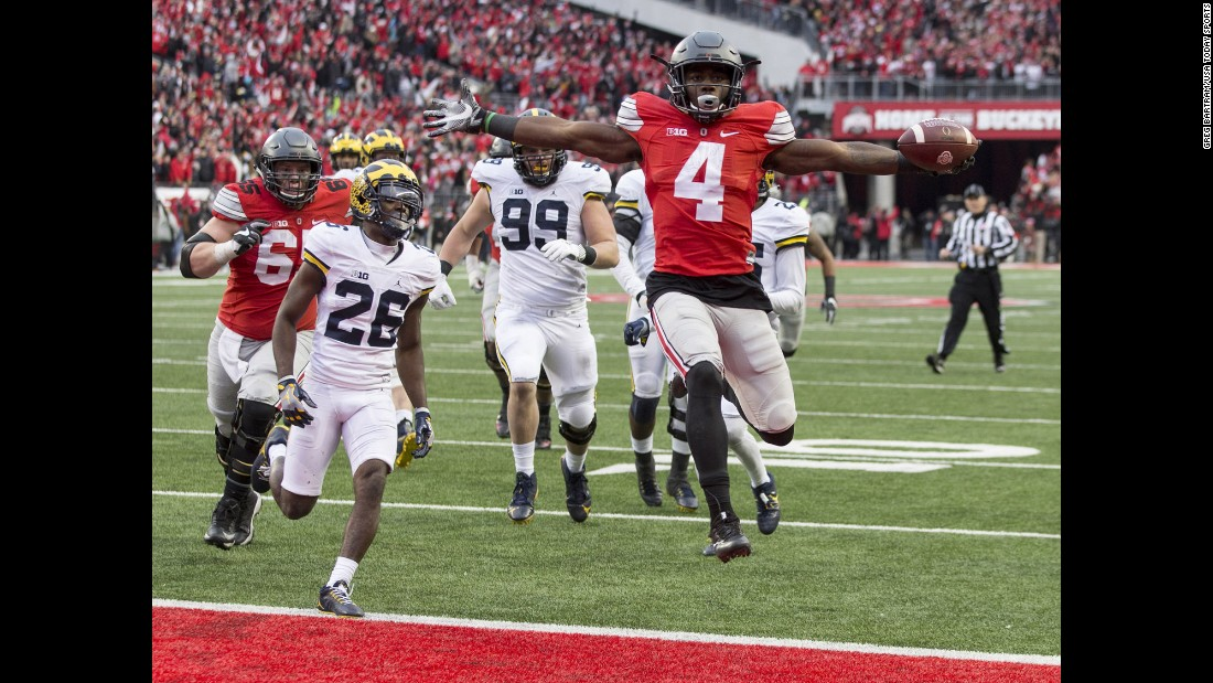 Ohio State running back Curtis Samuel scores a touchdown in double overtime to beat Michigan on Saturday, November 26. The rival teams came into the game ranked 2 and 3 by the College Football Playoff committee.