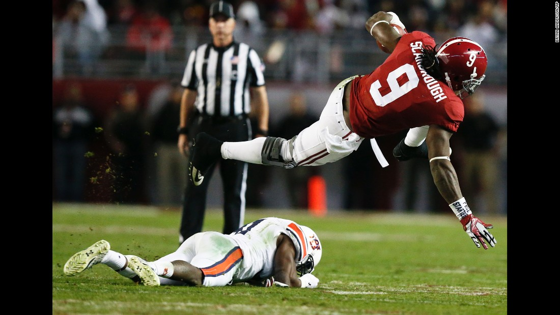 Alabama running back Bo Scarbrough jumps over an Auburn player during a college football game in Tuscaloosa, Alabama, on Saturday, November 26. Alabama won the rivalry game 30-12 to finish the regular season undefeated.