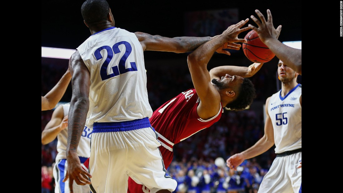 Indiana's James Blackmon Jr. has his shot blocked by Fort Wayne's Xzavier Taylor during a college basketball game in Fort Wayne, Indiana, on Tuesday, November 22. Fort Wayne upset the fifth-ranked Hoosiers 71-68 in overtime.