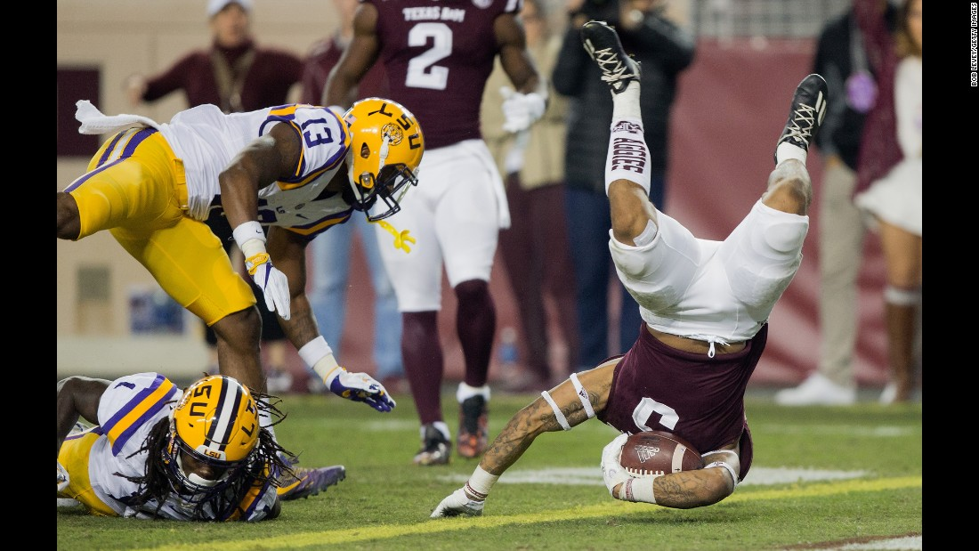 Texas A&M running back Trayveon Williams flips over the goal line, scoring a touchdown against LSU on Thursday, November 24. LSU won the Thanksgiving matchup 54-39.