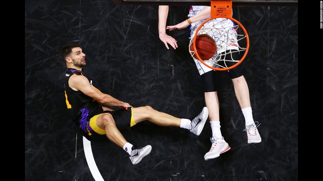 Sydney's Kevin Lisch, left, is fouled by Adelaide's Matt Hodgson during a NBL basketball game in Sydney on Monday, November 28.