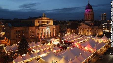 BERLIN, GERMANY - NOVEMBER 26:  The annual Christmas market at Gendarmenmarkt stands illuminated in the city center on its opening day on November 26, 2012 in Berlin, Germany. Christmas markets, with their stalls selling mulled wine, Christmas tree decorations and other delights, are an integral part of German Christmas tradition, and many of them opened across Germany today.  (Photo by Sean Gallup/Getty Images)