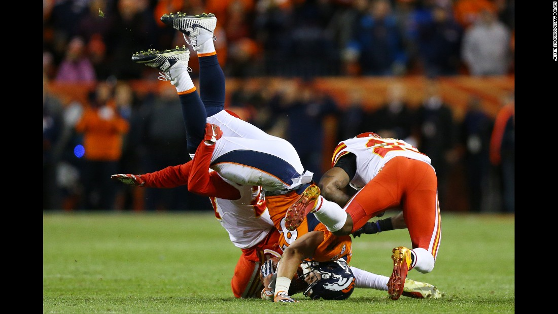 Denver tight end A.J. Derby, center, is tackled by two Kansas City Chiefs during an NFL game in Denver on Sunday, November 27.