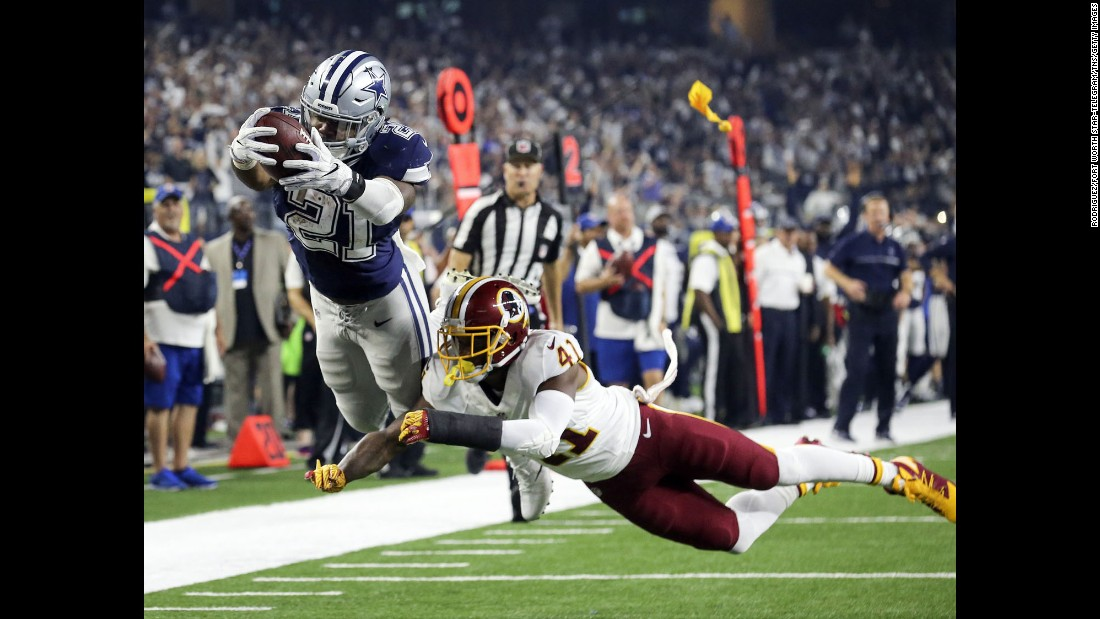 Dallas running back Ezekiel Elliott dives into the end zone during an NFL game against Washington on Thursday, November 24. The play was called back, but Dallas won 31-26 to improve its record to an NFL-best 10-1.