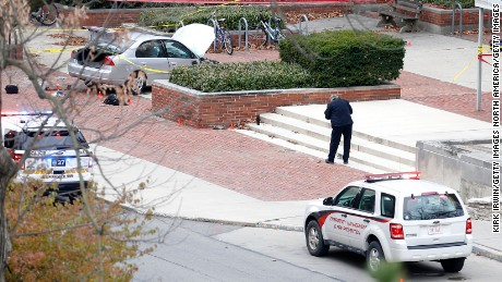 COLUMBUS, OH - NOVEMBER 28: Police investigate the scene where an individual used a car to crash into a group of students outside of Watts Hall on the Ohio State University campus on November 28, 2016 in Columbus, Ohio. At least nine people were injured when a suspect reportedly drove into a crowd of pedestrians and slashed several people with a knife before being fatally shot by university police. (Photo by Kirk Irwin/Getty Images)