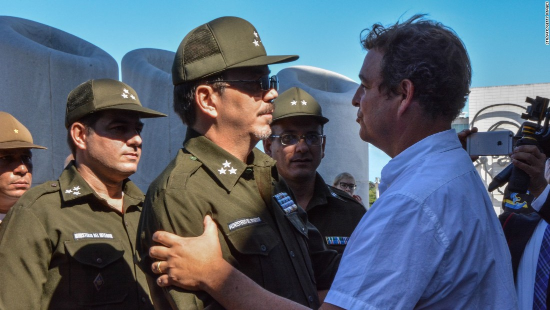 Alejandro Castro Espin, son of Cuban President Raul Castro, offers his condolences to his cousin Antonio Castro Soto del Valle, right, at Revolution Square.