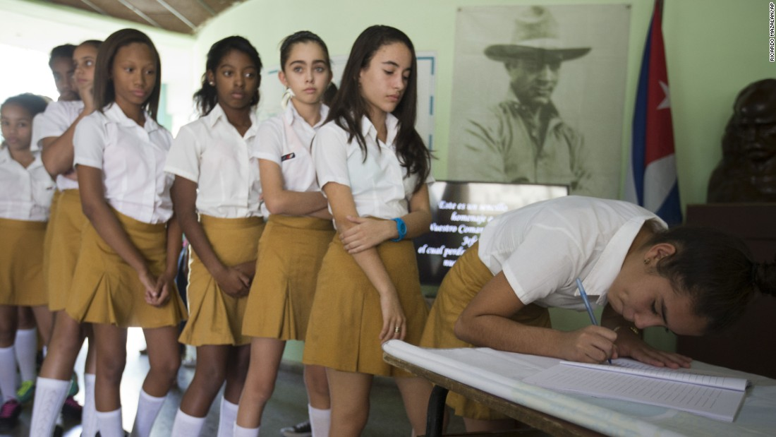 Students sign a book of condolences and a loyalty oath for Fidel Castro at a community center in Havana on November 28.