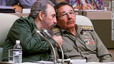 "HAVANA, CUBA:  (FILE) Picture taken 20 December 1999, in Havana of Cuban President Fidel Castro (L) speaking with his brother ad Armed Forces Minister Raul Castro during the IV Working Session of the National Assembly. A spokesman of Cuban President Fidel Castro read on Cuban National TV a document signed by him, 31 July 2006, by which he delegates power to his brother Raul Castro. Fidel Castro underwent surgery shortly after coming back from Mercosur?s Summit in Cordoba, Argentina. ""I do delegate, provisionally, my duties as first secretary of the Central Committee of the Communist Party in Cuba, to the second secretary, comrade Raul Castro Ruz,"" Castro said. (ELECTRONIC IMAGE)   AFP PHOTO/ADALBERTO ROQUE  (Photo credit should read ADALBERTO ROQUE/AFP/Getty Images)"