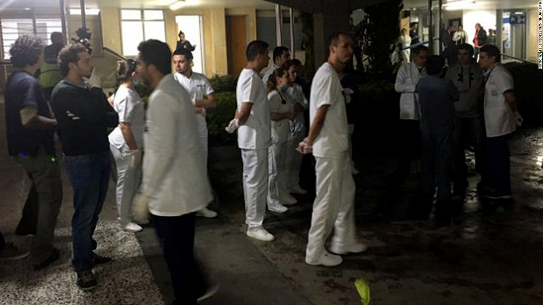 Medical staff wait for survivors in La Ceja.