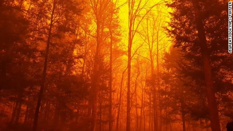 Fanned by strong winds and the Southeast's worst drought in nearly a decade, at least 14 fires burned in and around Gatlinburg, Tennessee, forcing evacuations from the popular tourist gateway and nearby communities. On Monday afternoon, a wildfire from the Great Smoky Mountains National Park spread rapidly into communities around it. By early Tuesday, emergency officials said about 100 homes were affected by the blaze.