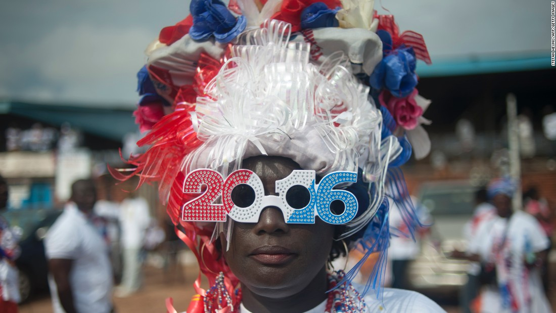 According to the electoral commission, Mahama won the 2012 election with 50.70 percent of the votes cast, compared to opposition candidate Nana Akufo-Addo's 47.74 percent.<br /><br />Picture here, a supporter of Ghana's largest opposition party New Patriotic Party (NPP) is seen at the party manifesto launch in Accra on October 9, 2016. Photo Stefan Heunis/AFP/Getty Images.