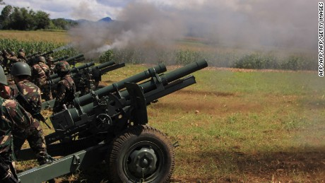 Philippines troops fire cannon at Islamist militant positions in Mindanao.