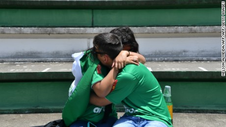 People cry during a tribute to the players of Brazilian team Chapecoense Real who were killed in a plane accident in the Colombian mountains, at the club's Arena Conda stadium in Chapeco, in the southern Brazilian state of Santa Catarina, on November 29, 2016. Players of the Chapecoense were among 81 people on board the doomed flight that crashed into mountains in northwestern Colombia, in which officials said just six people were thought to have survived, including three of the players. Chapecoense had risen from obscurity to make it to the Copa Sudamericana finals scheduled for Wednesday against Atletico Nacional of Colombia.  / AFP / Nelson ALMEIDA        (Photo credit should read NELSON ALMEIDA/AFP/Getty Images)