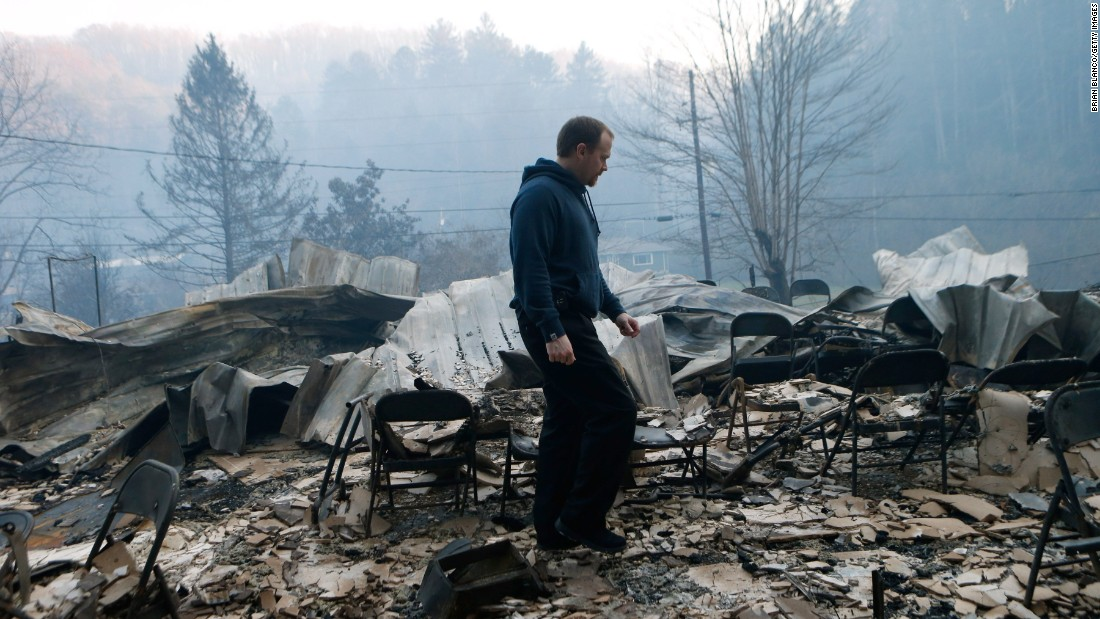 Trevor Cates inspects the damage to the Banner Missionary Baptist Church in Gatlinburg on November 29.