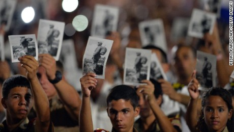 People participate in a massive rally at Revolution Square in Havana in honor of late leader Fidel Castro.