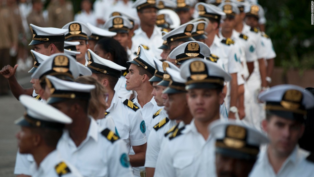 Navy cadets join the crowd during the rally on November 29.
