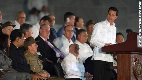 Mexican President Enrique Pena Nieto (R) delivers a speech next to Cuban President Raul Castro (5-L), Venezuela's President Nicolas Maduro (4-L), Venezuelan First Lady Cilia Flores (3-L) and Bolivian President Evo Morales (L), during a massive rally at Revolution Square in Havana in honor of Cuban late leader Fidel Castro. Castro -- who ruled from 1959 until an illness forced him to hand power to his brother Raul in 2006 -- died Friday at age 90. The cause of death has not been announced. / AFP / JUAN BARRETO        (Photo credit should read JUAN BARRETO/AFP/Getty Images)